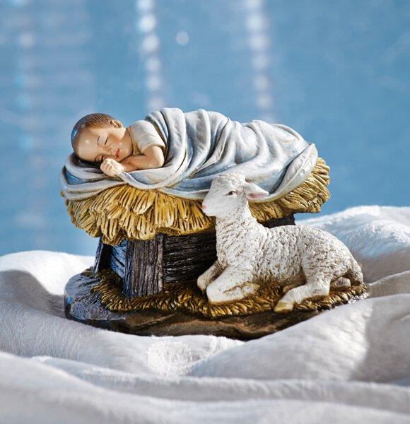 Nativity scene figure of Baby Jesus sleeping with a lamb